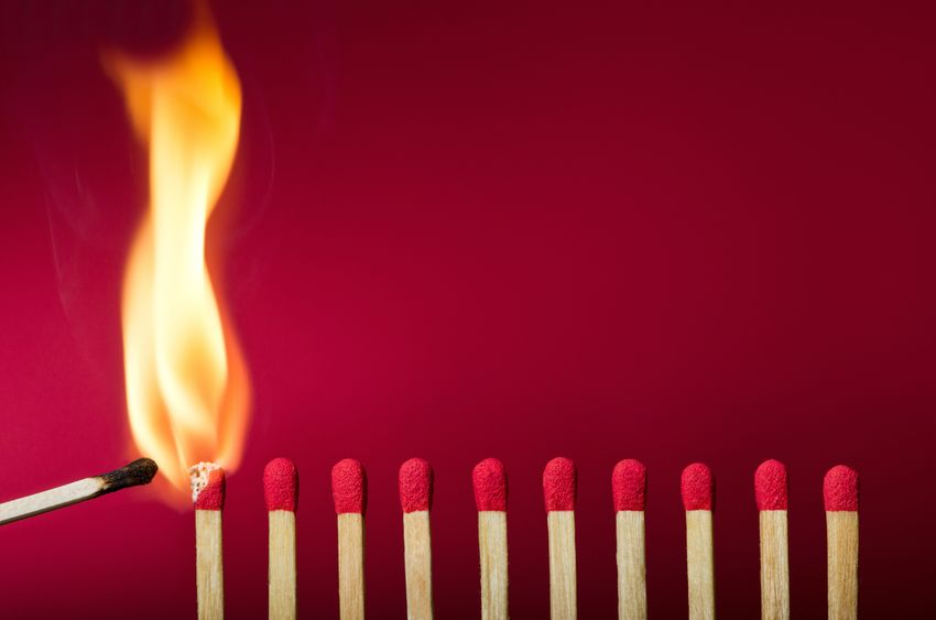 Stock photo image of a line of matches catching on fire.
