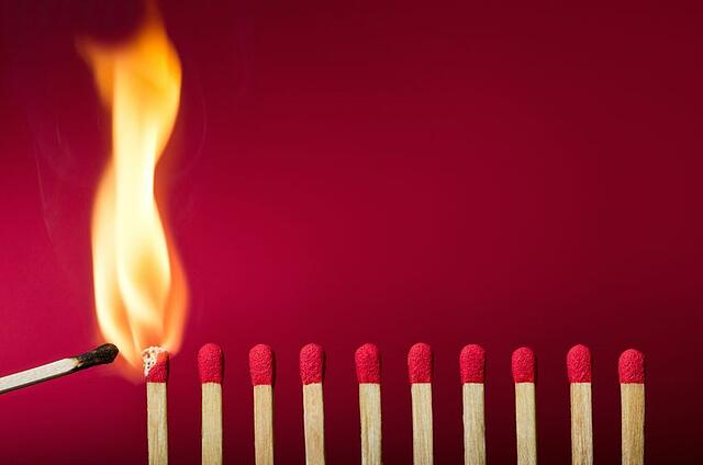 Stock photo of row of matches being lit.