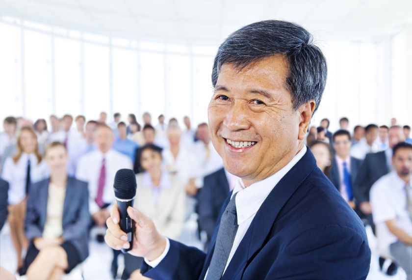 Stock photo of Asian businessman speaking at a conference on leadership.
