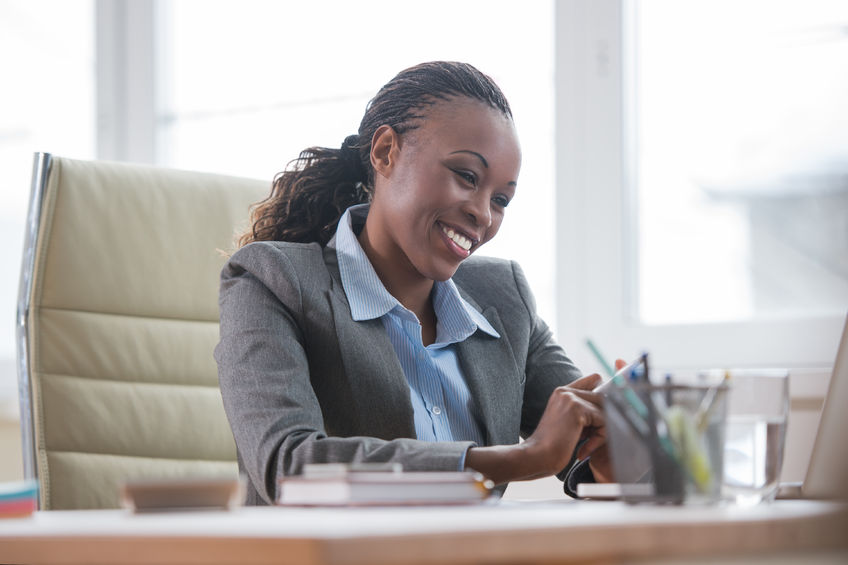 Black business woman model demonstrating one of the essential qualities of leadership.
