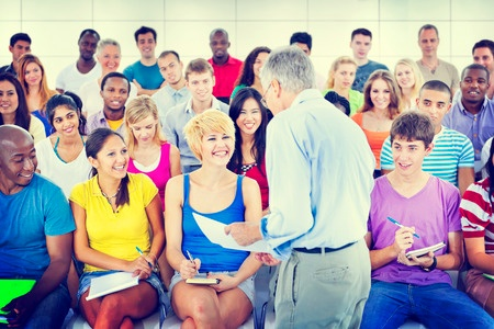 Stock photo of teacher with audience.
