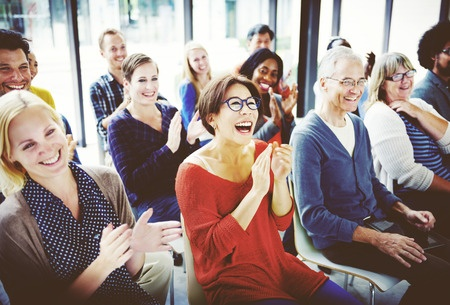 Stock photo of audience applauding and enjoying a performance.