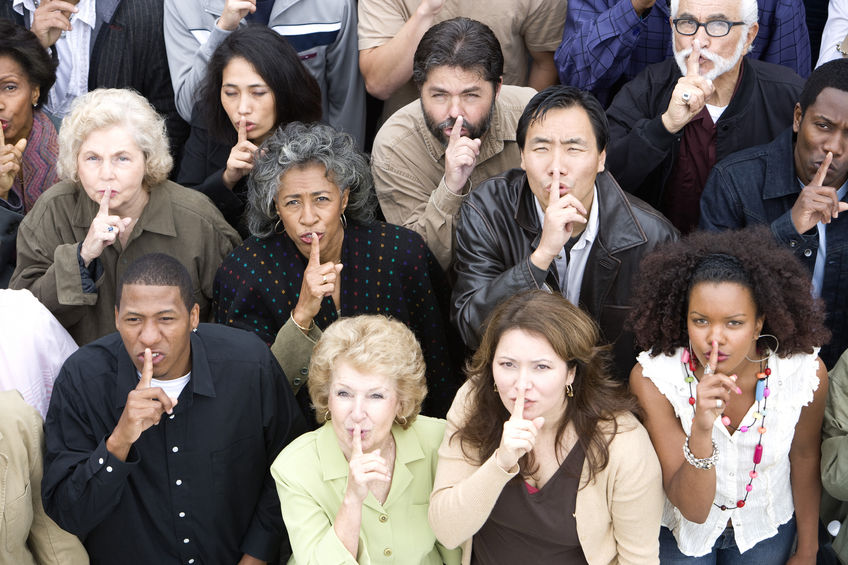 People making the 'silence' or 'shush' gesture due to the power of silence.