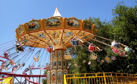 Stock photo of amusement park ride at town carnival.