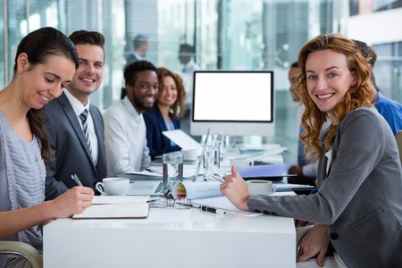 Photo of happy business people during video conference or teleconference.
