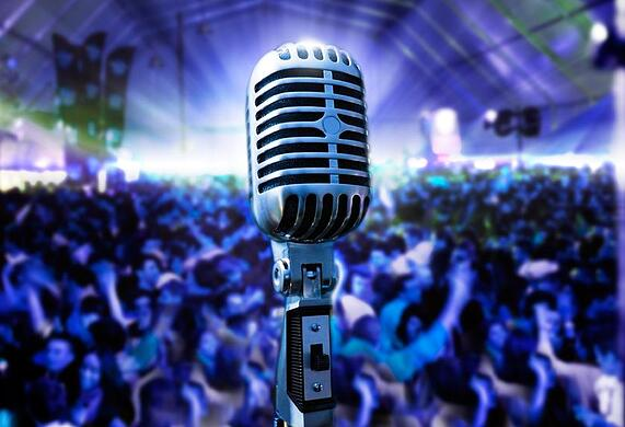 Easy ways to be a more engaging public speaker include charisma and stage presence.