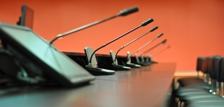 Stock photo of microphones on table.