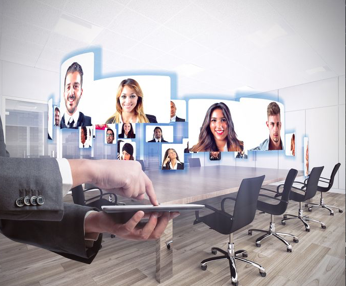 Photo of happy employees at videoconference or teleconference demonstrating telepresence.