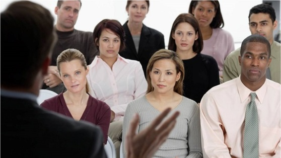 Stock photo of audience listening to a business presentation.