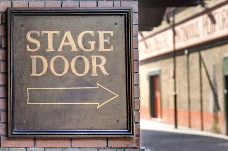 Image of sign reading stage door at a theater.