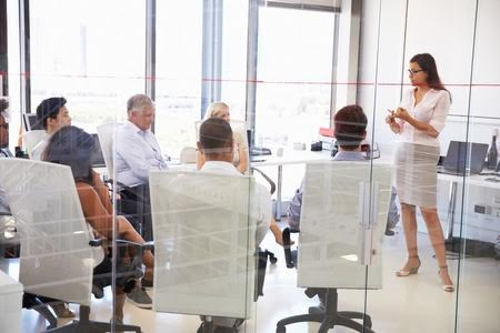 Stock photo of business woman at a meeting using body language.