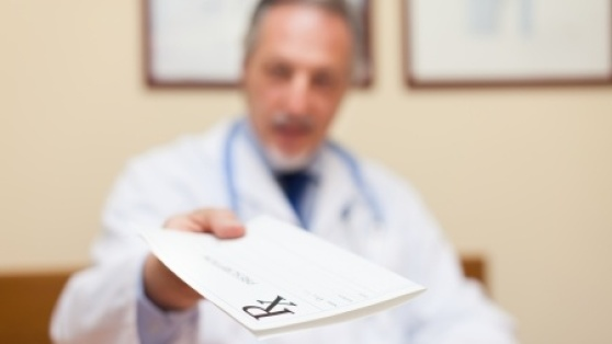 Stock photo of physician giving a prescription to a patient.