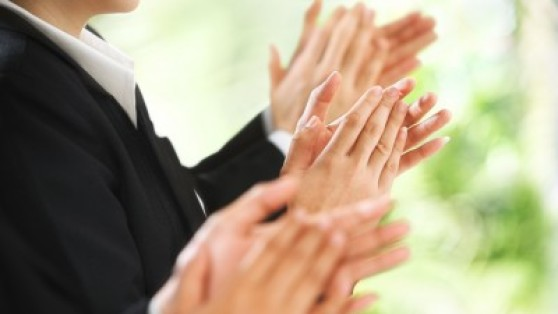 Stock photo of applause at a business conference.