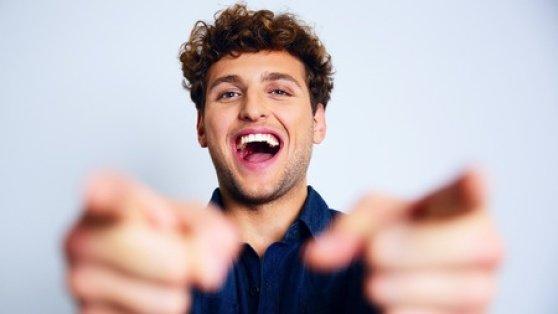 smiling_man_pointing