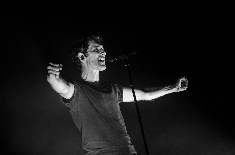 Stock black & white photo of actor gesturing on a stage.