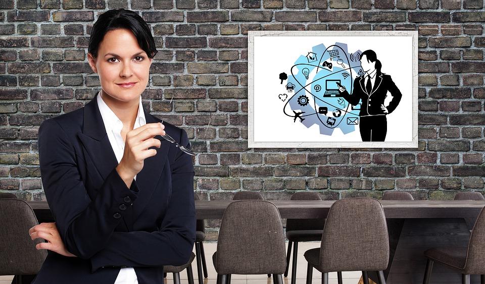Businesswoman showing PowerPoint slide.