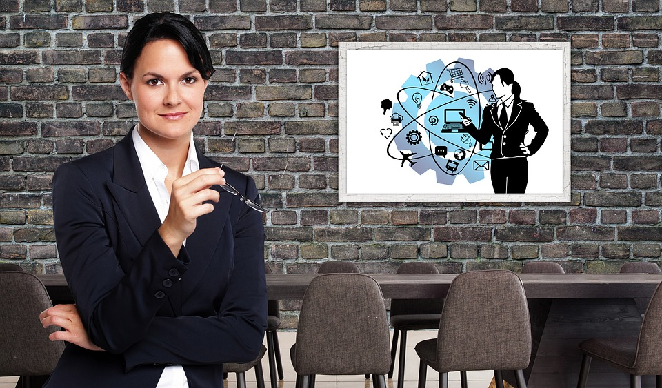 Businesswoman showing PowerPoint slide.