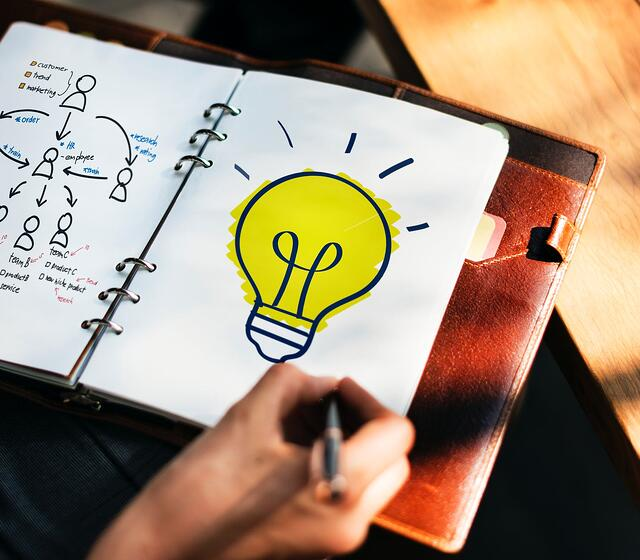 Photo of drawing of light bulb indicating an idea.
