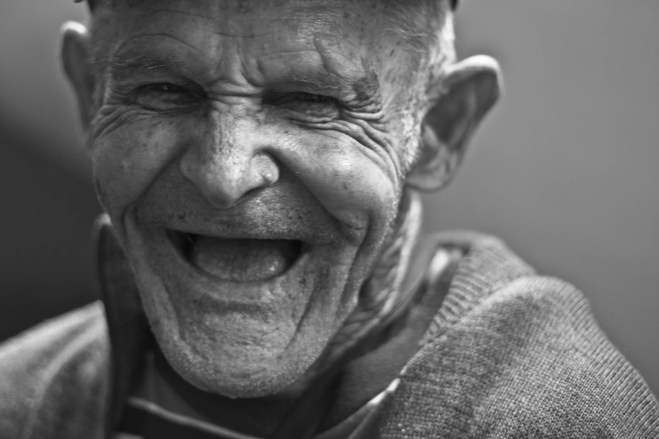Stock photo of old man laughing.