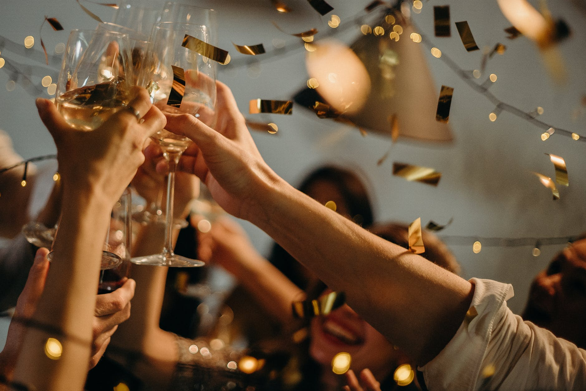 Stock photo showing New Year's Eve celebration with champagne glasses.