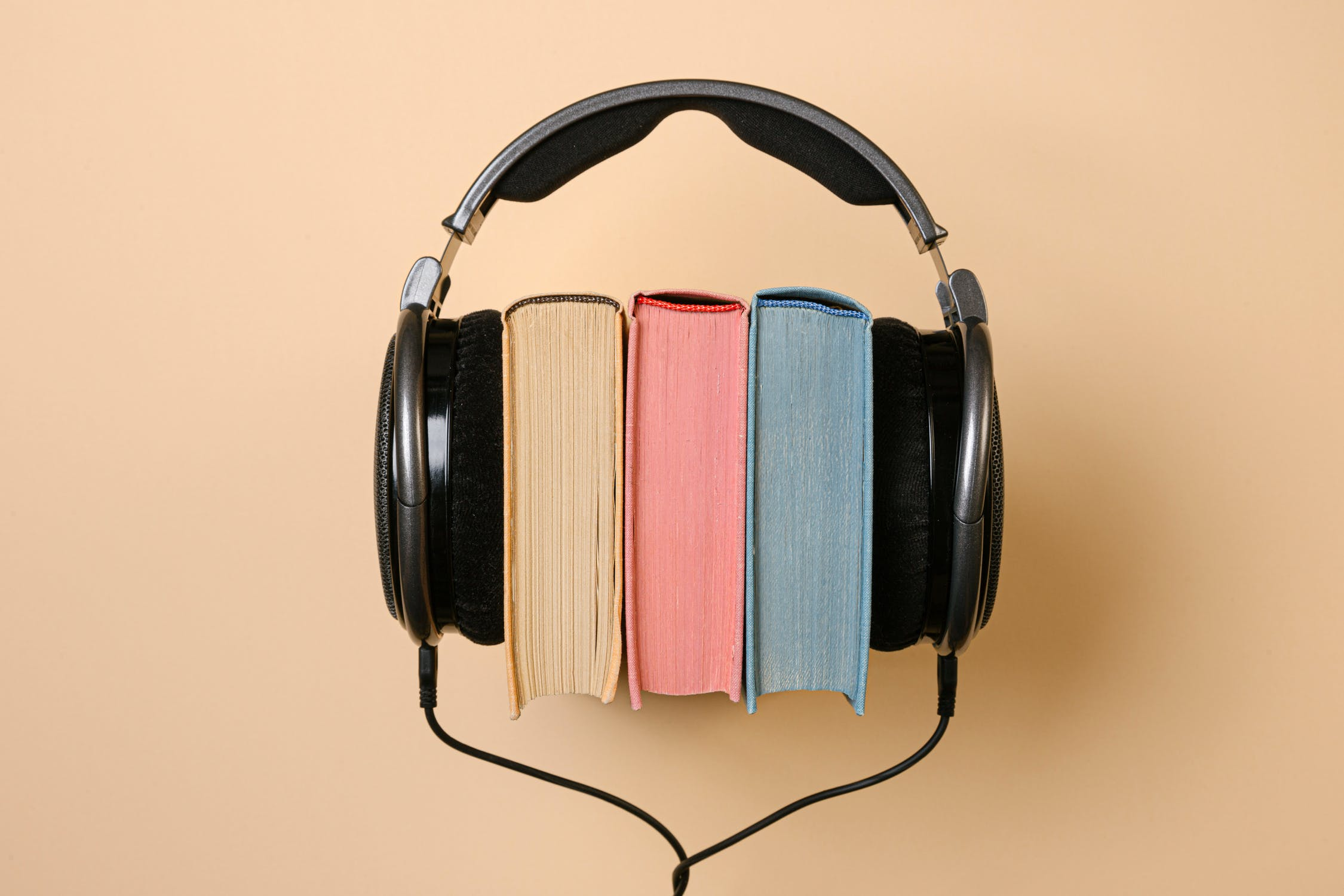 Listening to audiobooks can teach you how to use your voice in business meetings.
