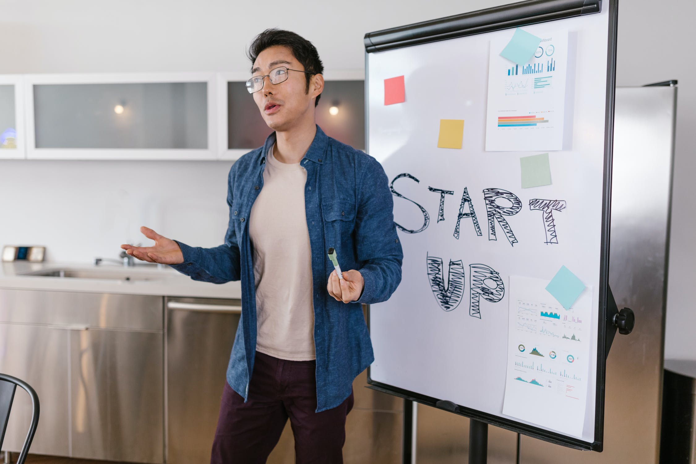 Stock photo of Asian-American male delivering a business presentation.
