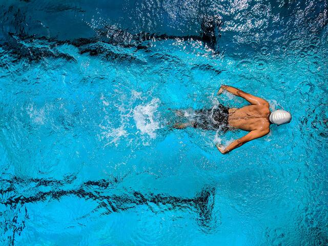 Stock photo of competitor swimmer in pool.