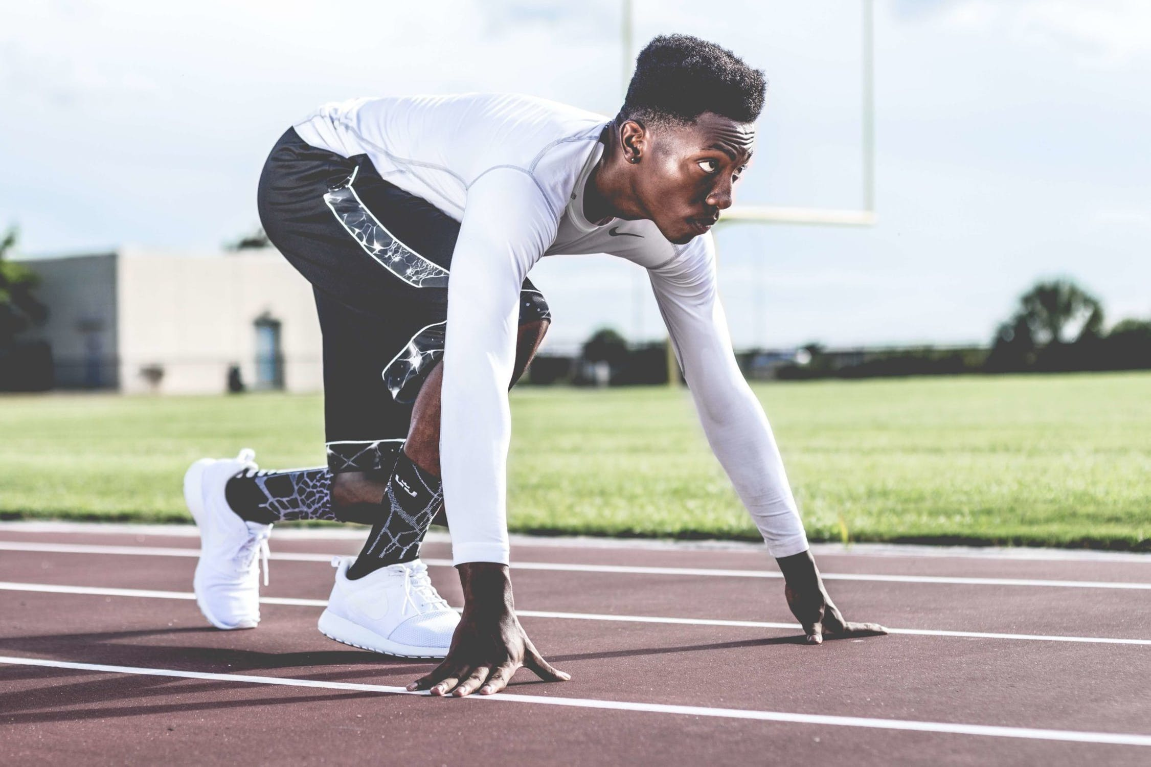 Stock photo of African American athlete at the starting line of a race.