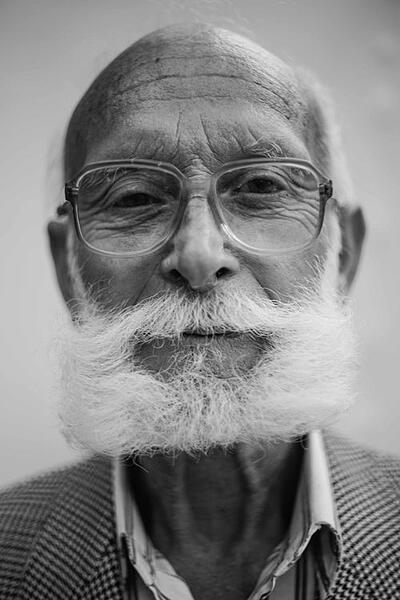 Stock photo of elderly man with full beard.