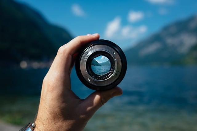 Stock photo of landscape through camera lens.