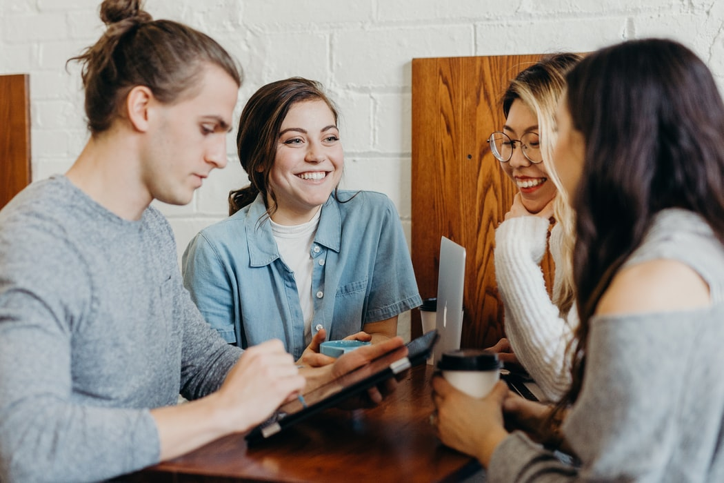 Stock photo of friends chatting.