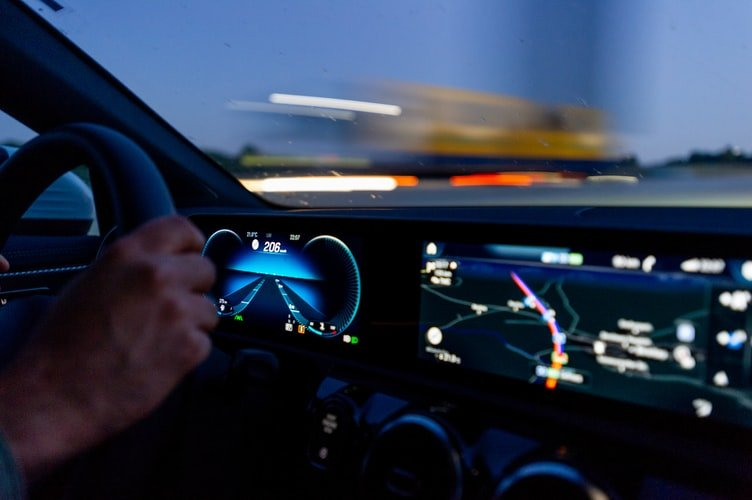 Stock photo of dashboard in car going fast.