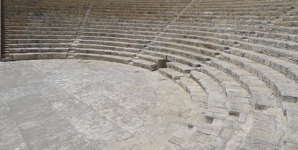 Stock photo of ancient Greek theater or amphitheater with stone steps.