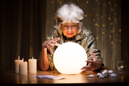 Stock photo of woman with crystal ball, a mindreader.