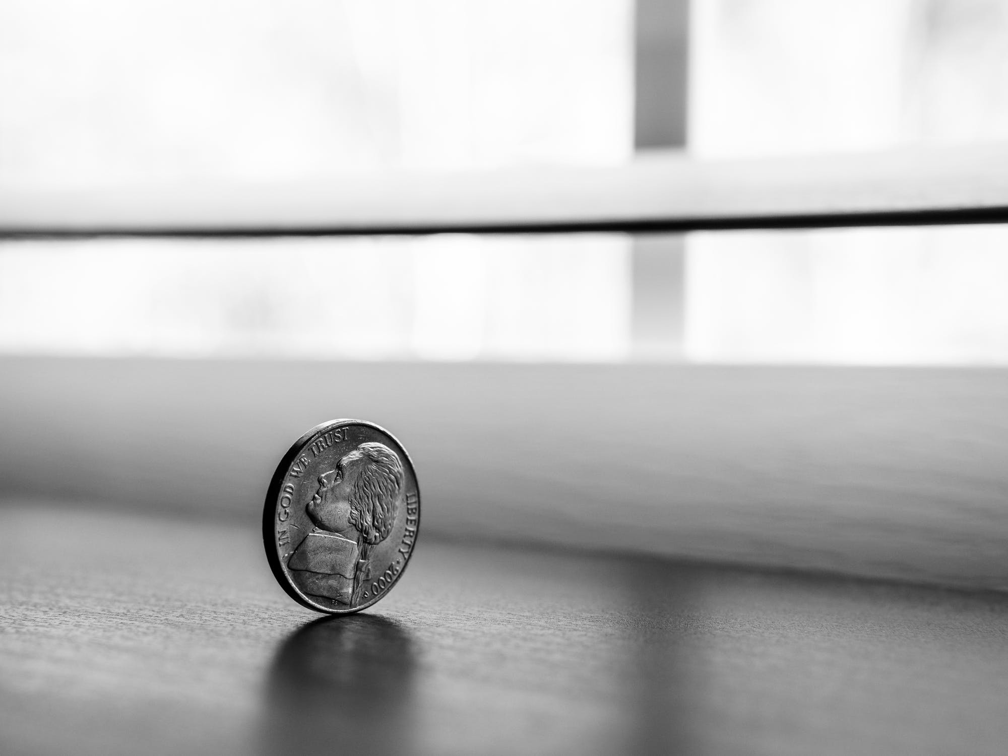 Stock image of coin, heads or tails equals success or failure.