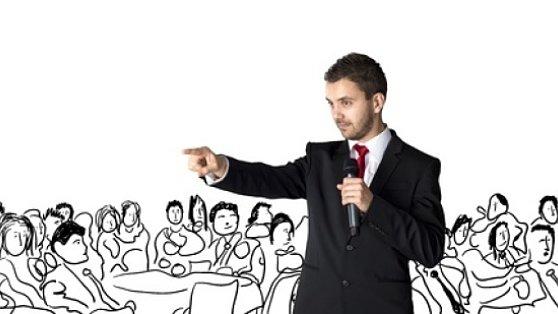 speaker gesturing to audience